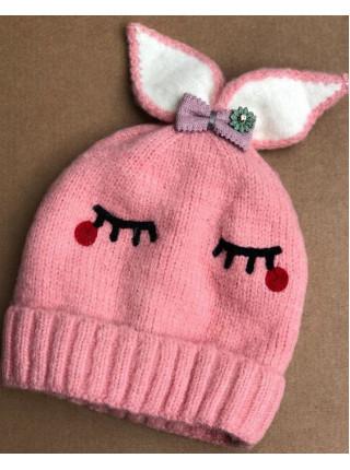 Вязаная шапка для девочки с бантиком