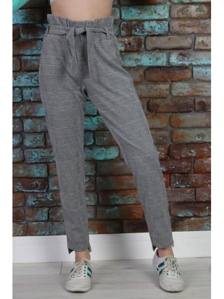 Модные детские брюки в клетку для девочки