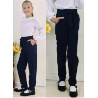 Шкільні штани в дрібну клітинку на дівчинку